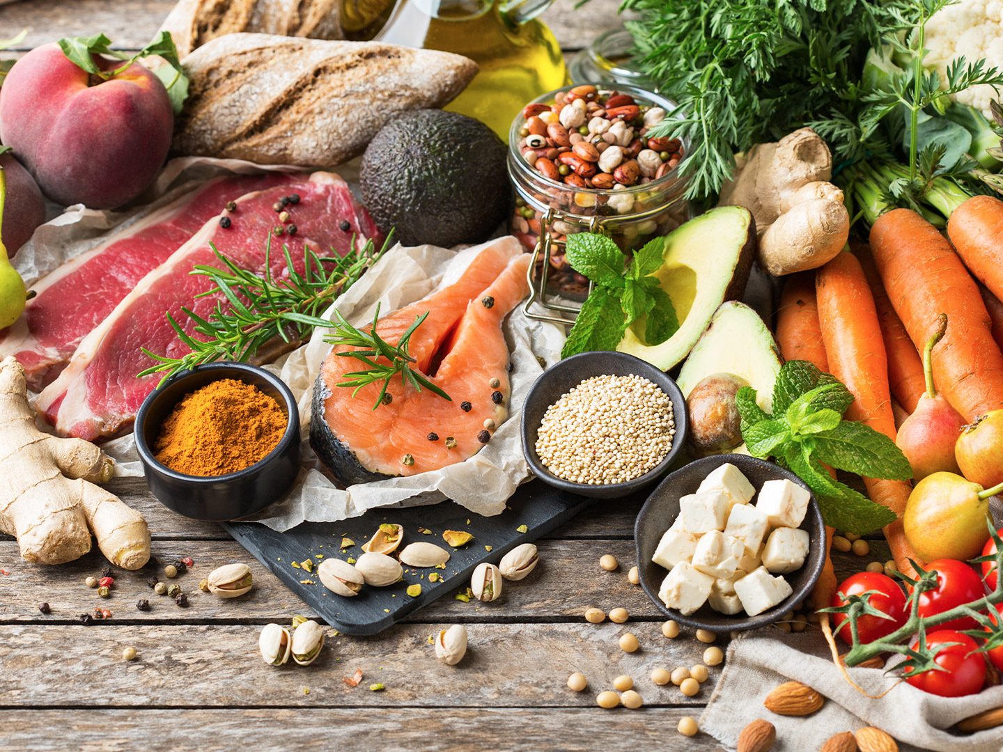 A spread of different fruits, vegetables, meats, spices, nuts and grains
