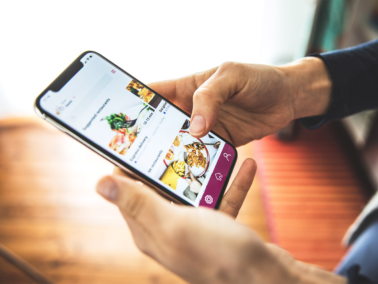 Close up image of caucasian hands scrolling through a food delivery app