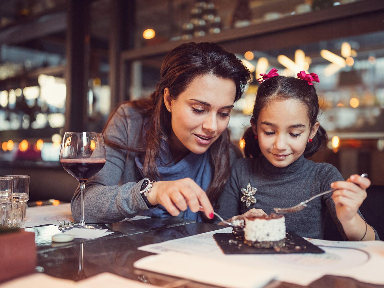 Parent and kid eating dessert